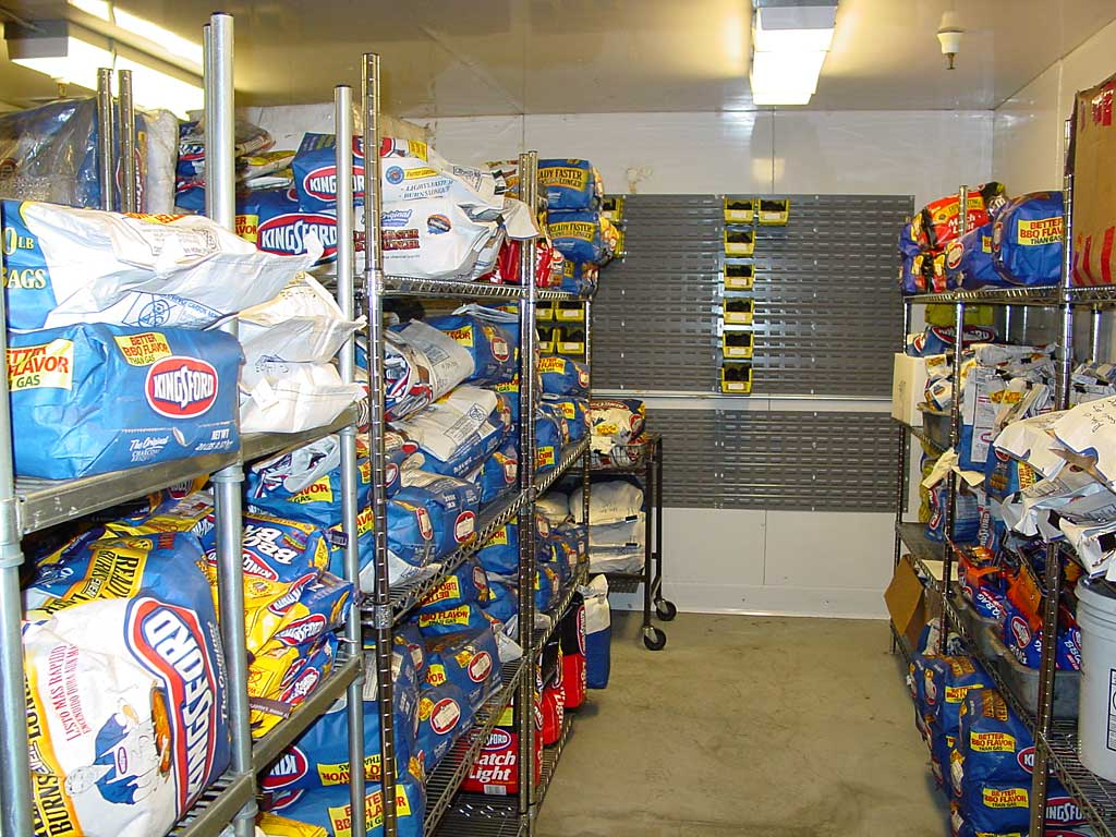 Kingsford and competitive products are stored in this climate- controlled room prior to testing. The yellow bins on the back wall contain sample briquettes from factory production runs. There were many more of these bins in other parts of the room. This photo shows half of the entire room.