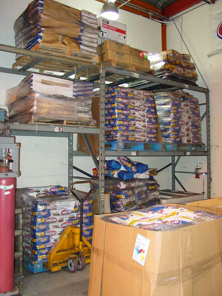 Pallets of old and new Kingsford are stored in the warehouse adjacent to the testing lab. Notice the Weber kettle box on the top shelf.