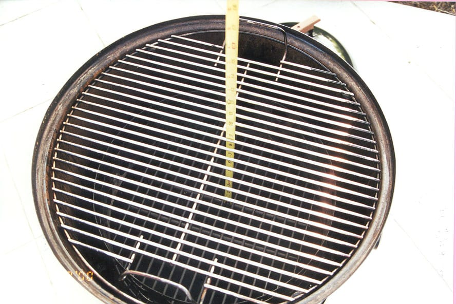 "8-1/2"" from charcoal grate to cooking surface"