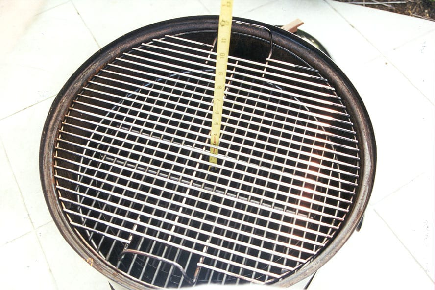 "3-1/2"" from charcoal grate to cooking surface"