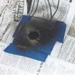 Spray painting chips around hole with high temp paint