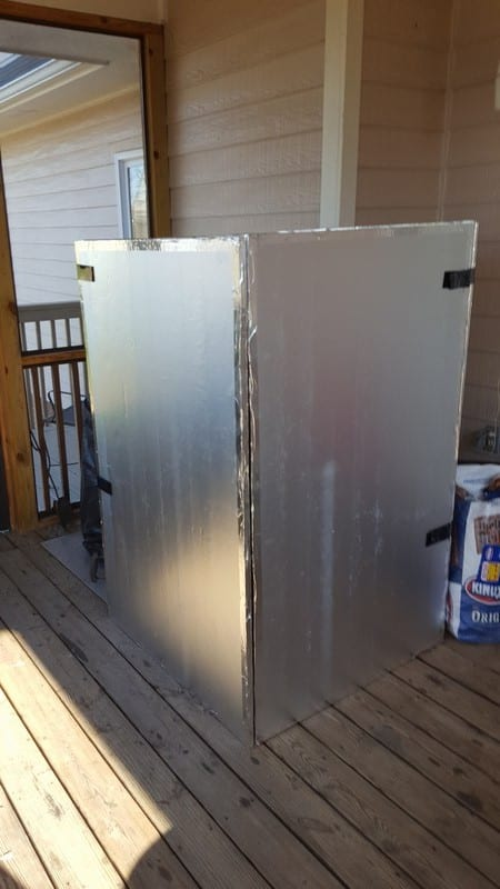 Aluminum-covered foam windbreak in closed position