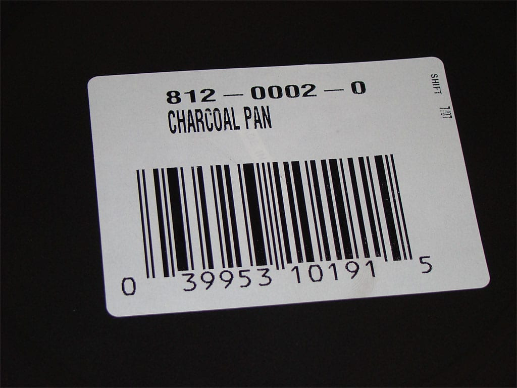 Close-up of Brinkmann charcoal pan retail part number and UPC code