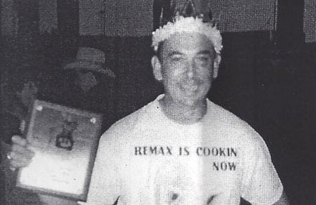 Mike Scrutchfield shows off a first place trophy and crown at the 1993 American Royal Open