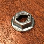 "Close-up of Hillman Thread Cutting Nut 7/16 Hex 1/4"" Stud"
