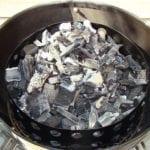 Hot coals spread over unlit lump