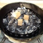 Smoke wood on top of hot coals