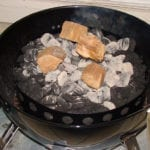 Smoke wood and hot coals in charcoal chamber