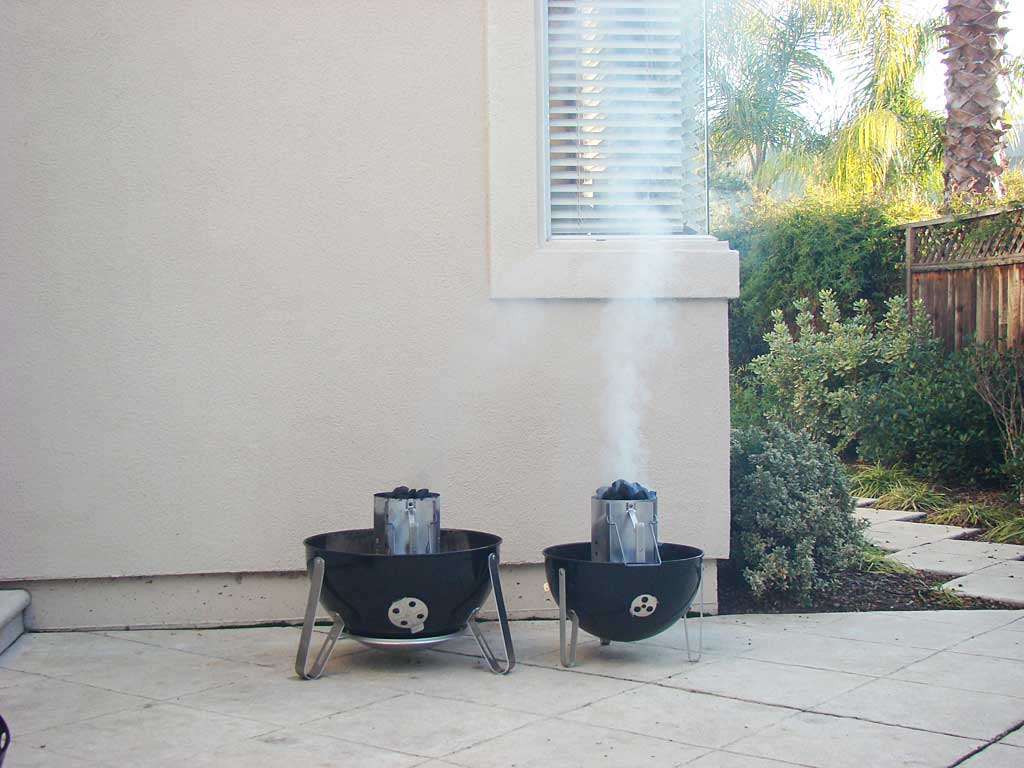 "Competition Briquets (right) produce a tall plume of white smoke compared to ""blue bag"" briquettes (left)"