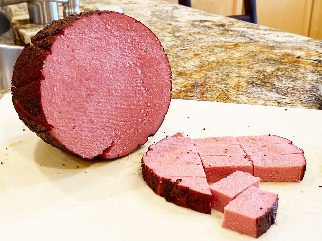Cutting smoked bologna into cubes
