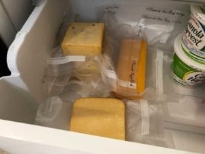 Cheese mellowing in the refrigerator for 2-4 weeks