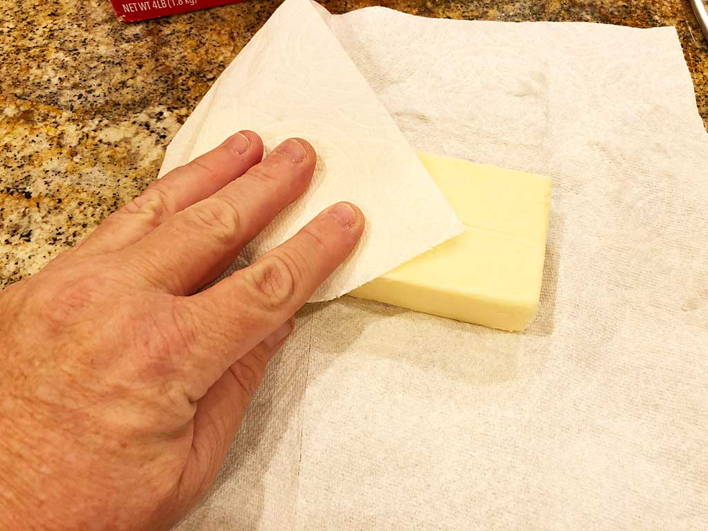 Removing condensation from cheese