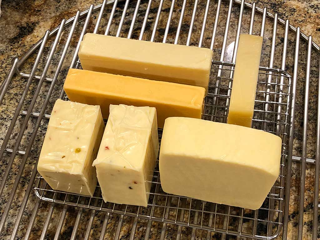 Arranging cheese blocks on wire rack