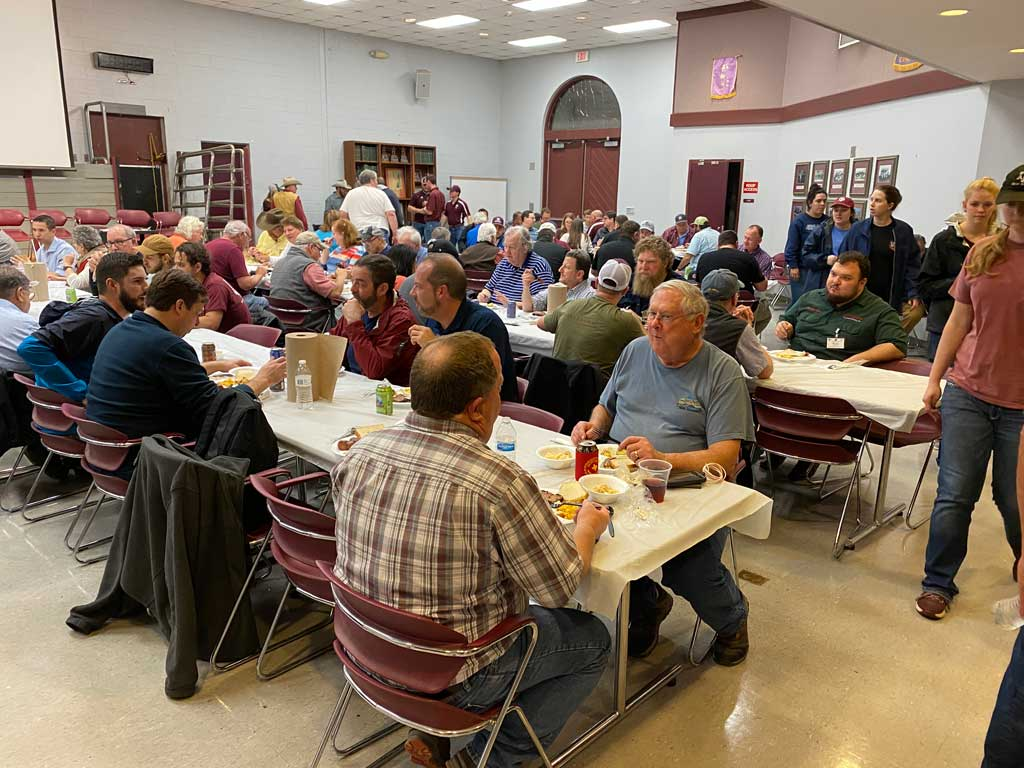 Diners enjoying a brisket dinner at the TAMU Beef Cattle Center