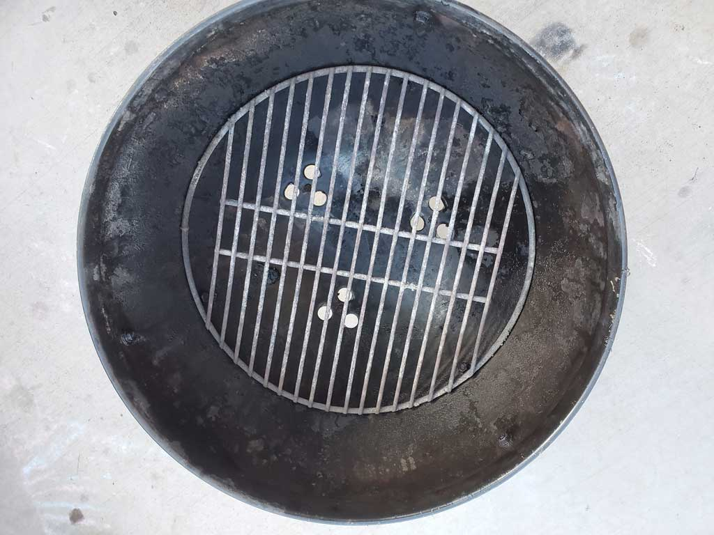 Vents stamped below charcoal grate