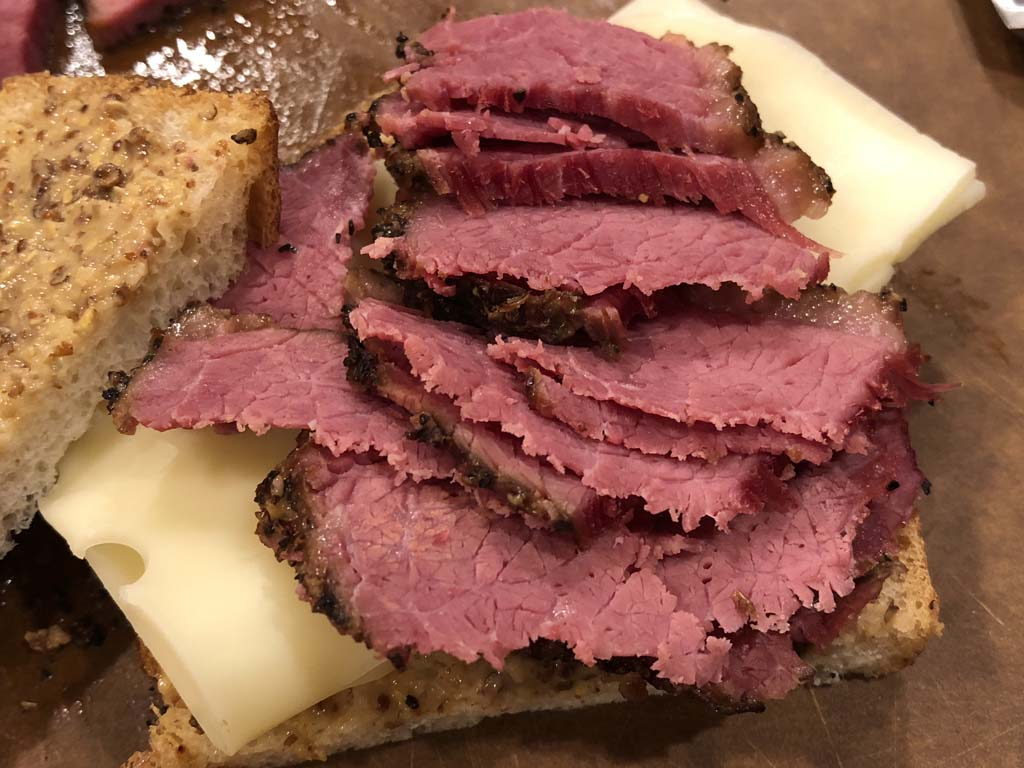 Sliced steamed pastrami on a sandwich