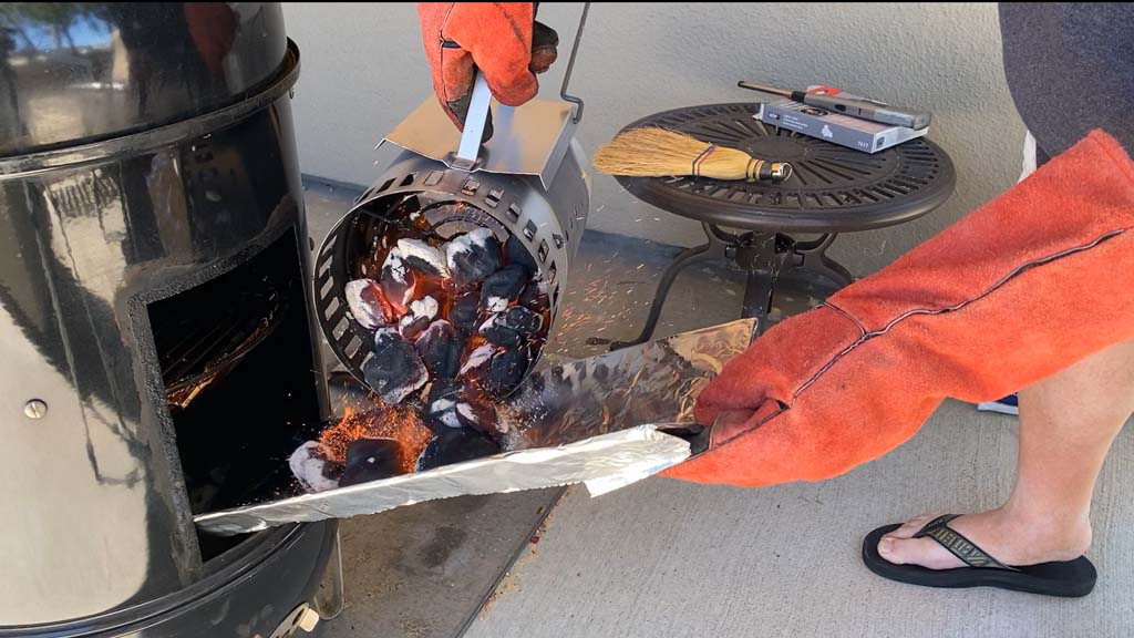Adding hot charcoal using cardboard chute
