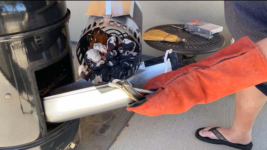 Adding lit charcoal using aluminum duct chute