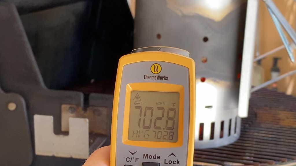 Measuring 1984 Kingsford Briquets temperature with an infrared thermometer