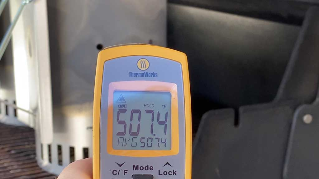 Measuring 2020 Kingsford Briquets temperature with an infrared thermometer