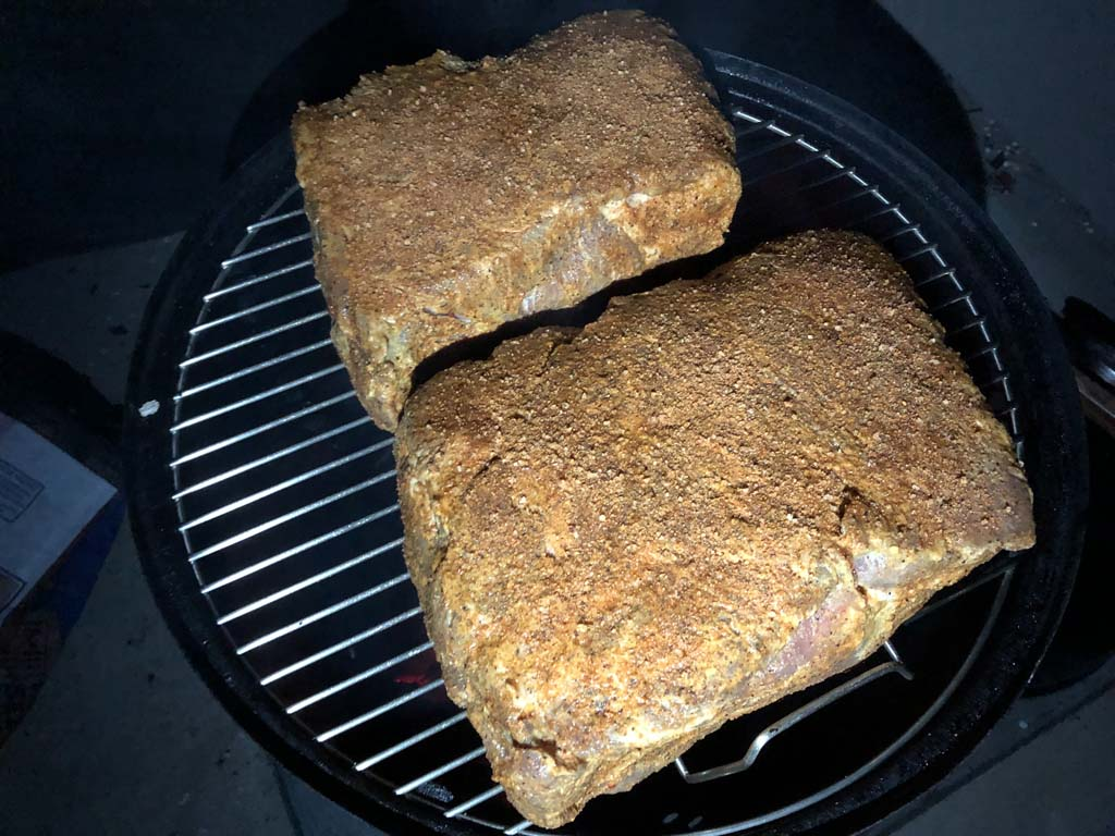 Pork butts on top cooking grate