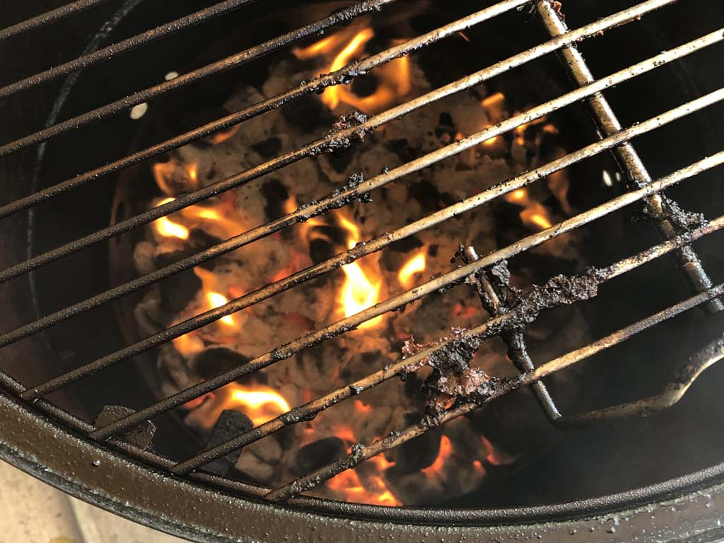 Pork fat burning in hot charcoal