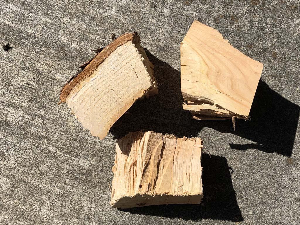 Three fist-sized chunks of apple smoke wood