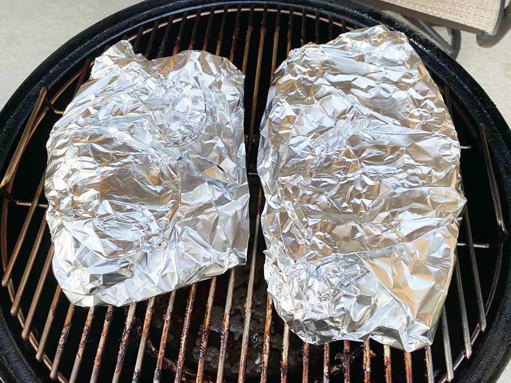 Pork butt pieces wrapped in aluminum foil
