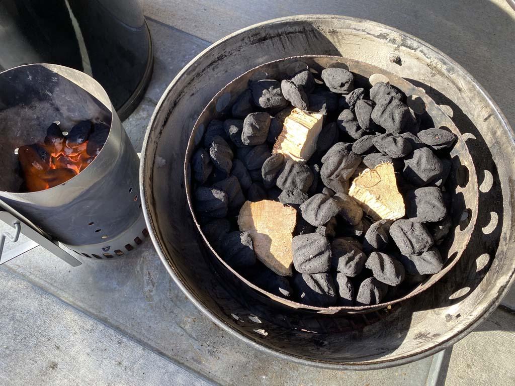 Smoke wood nestled into unlit charcoal