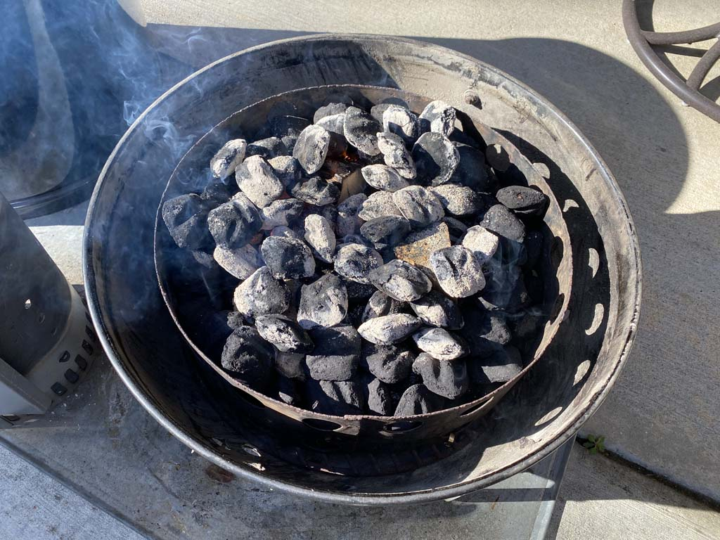 40 lit briquettes spread over unlit charcoal and smoke wood