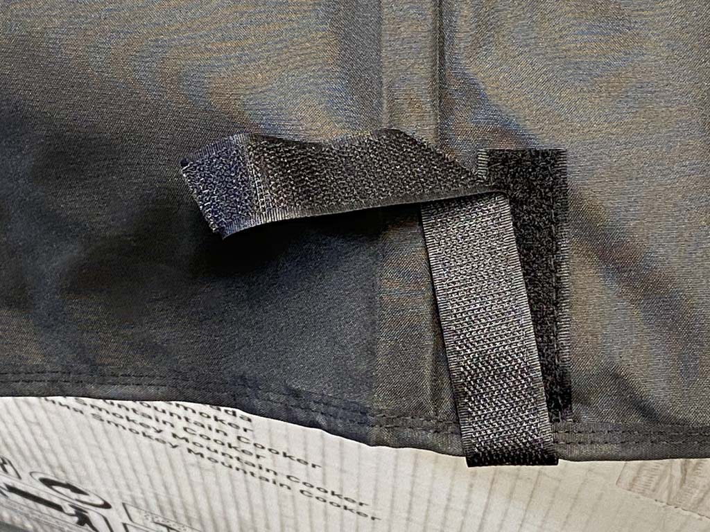 Velcro leg strap secures cover to grill