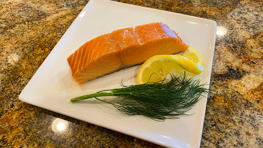 Simple smoked salmon on plate with lemon and dill