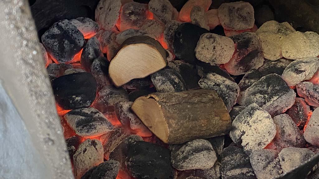 Smoke wood on top of hot charcoal